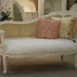 Shabby Chic Chaise Lounge Plus Decorative Throw Pillows And Pedestal Flower Vase For Floor Display