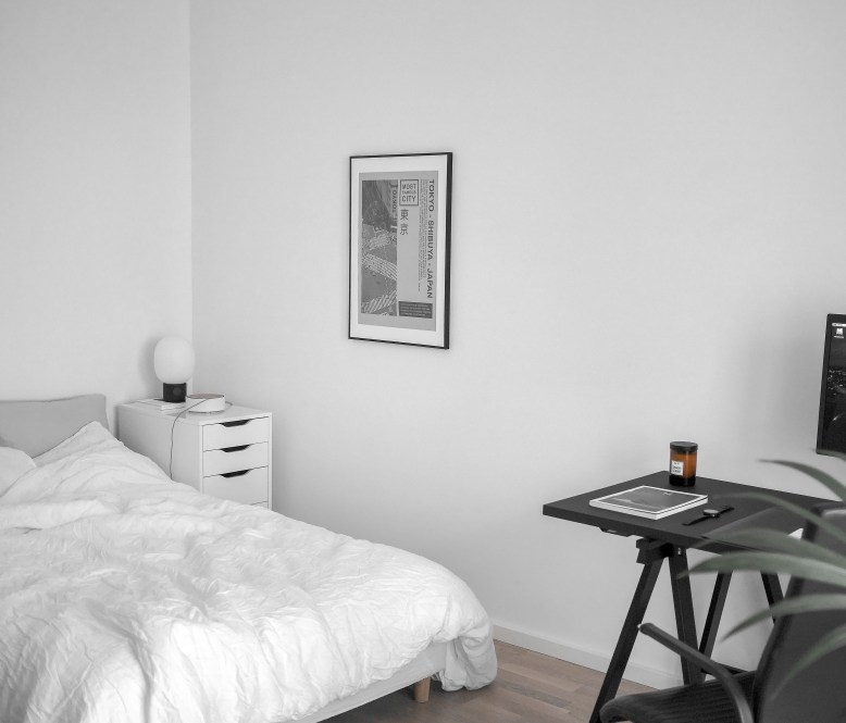 Black Wooden Table Beside White Bed