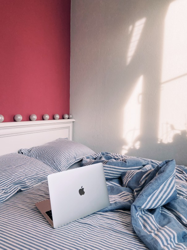 Silver Macbook On Blue And White Bed Linen