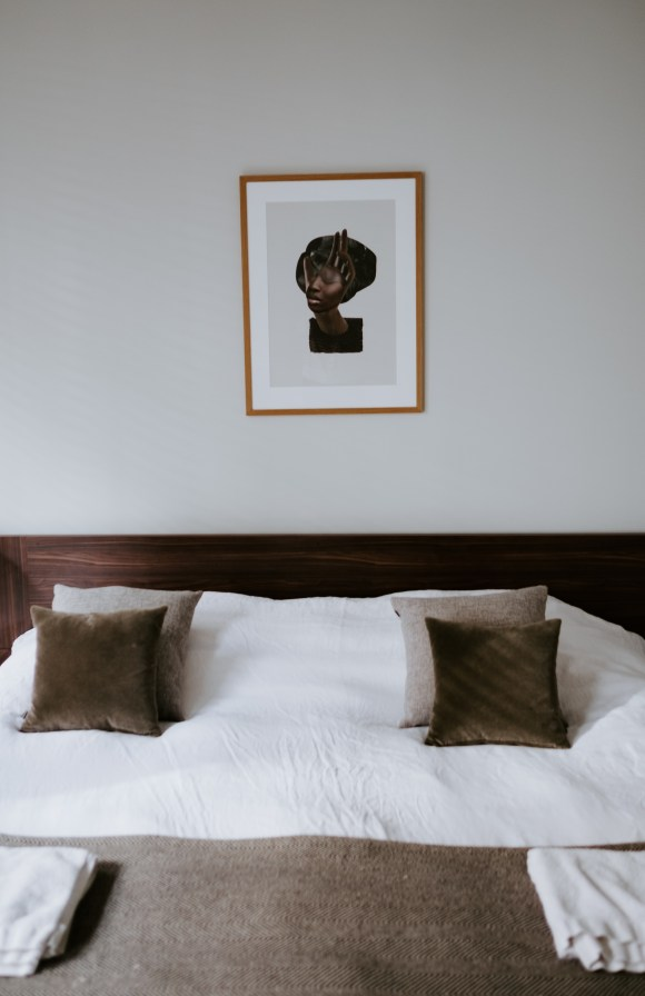 White And Brown Bedspread Set Inside Bedroom